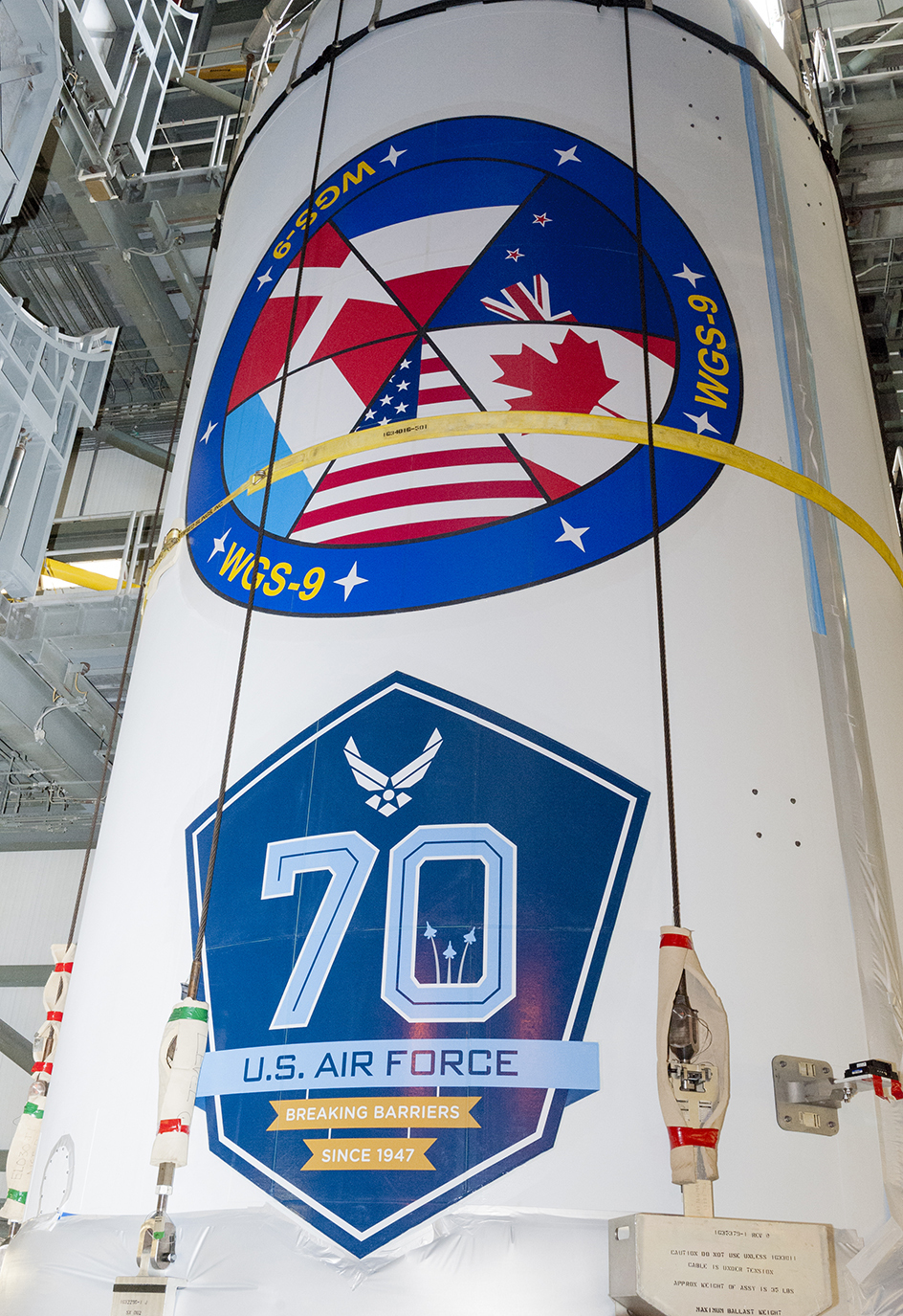 The WGS-0 constellation satellite displays a crest featuring the flags of the partner nations (clockwise from the bottom): the United States, Luxembourg, Denmark, The Netherlands, New Zealand and Canada. PHOTO: PHOTO: © United Launch Alliance