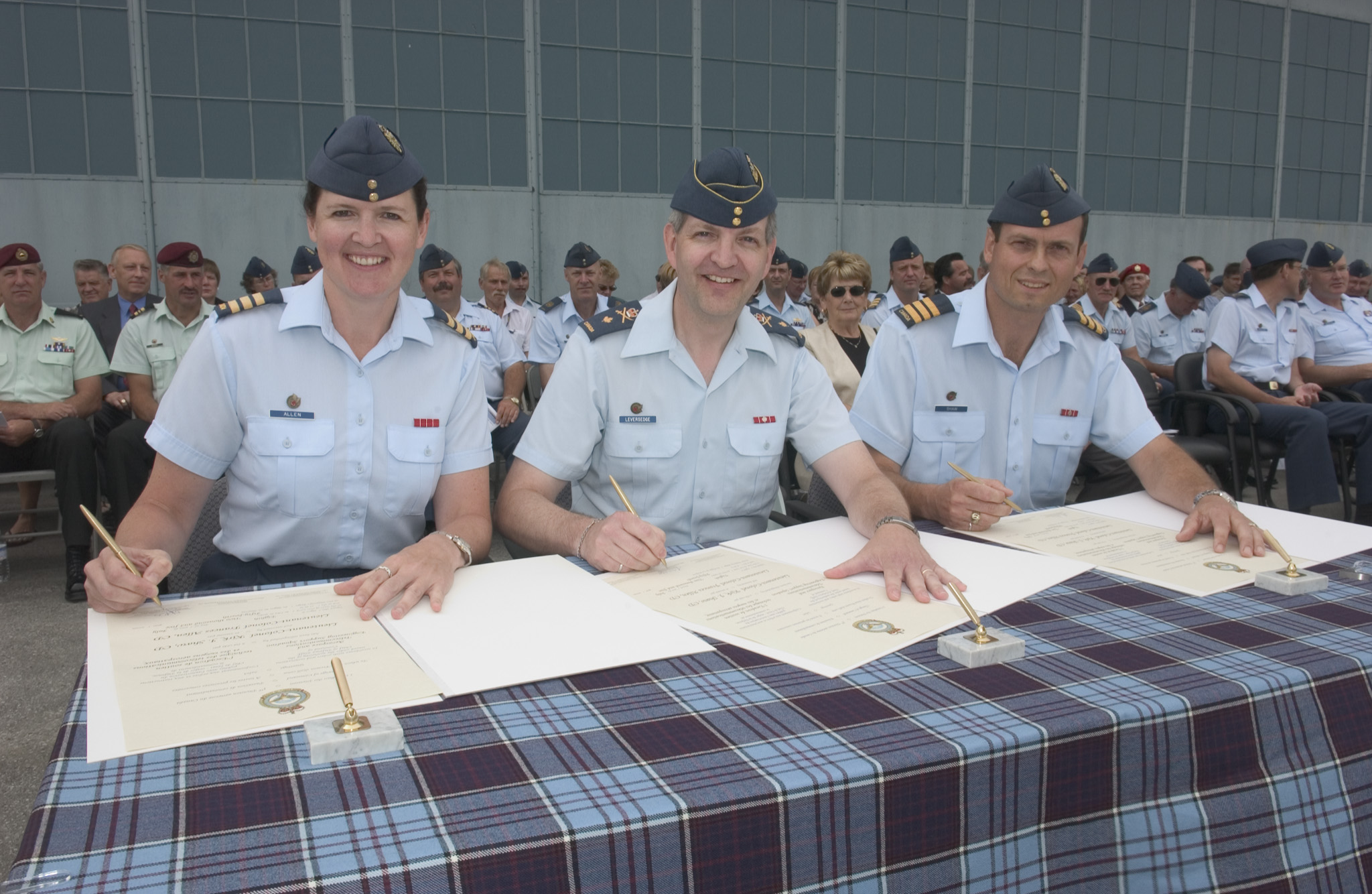 On July 8, 2005, Lieutenant-Colonel Frances Allen (left) assumes command of the Aerospace and Telecommunications Engineering Support Squadron at 8 Wing Trenton, Ontario, from  Lieutenant-Colonel Kirk Shaw (right) in the presence of the presiding officer,  Brigadier-General Terrence Leversedge. PHOTO: Corporal Jean-Francois Neron, TN2005-0528-05d