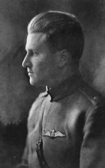 A black-and-white left profile of a young man wearing a high-necked military tunic.