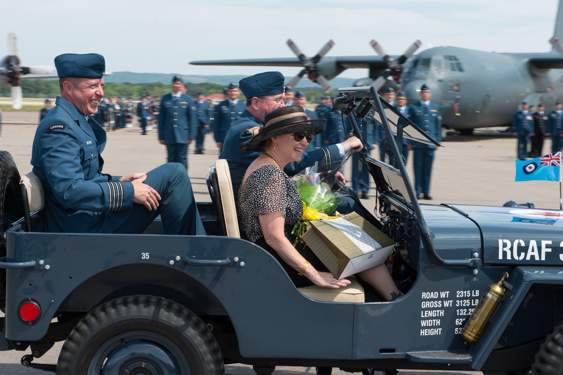 Former 14 Wing Greenwood commander Colonel Patrick Thauberger and his wife, Kathy, depart the parade square in a Royal Canadian Air Force heritage jeep after the July 20, 2017, change of command ceremony. PHOTO: Corporal Dan Salisbury, GD04-2017-0453-040