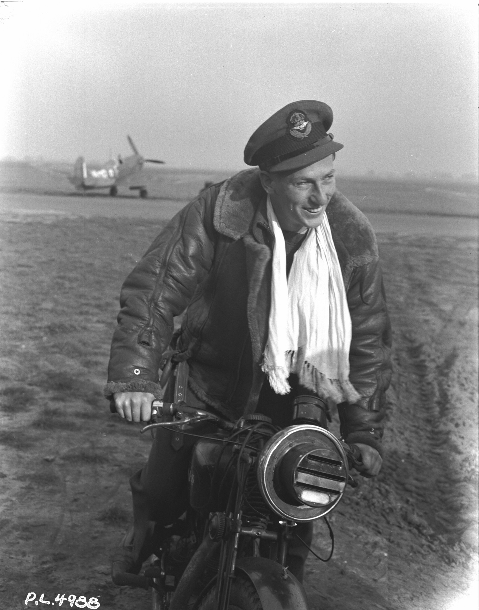 "Pilot Officer Robert Wendell ""Buck"" McNair flew with 411 Squadron during the raid on Dieppe on August 19, 1942. This photograph was taken ""somewhere in England"". PHOTO: DND Archives, PL-4988"