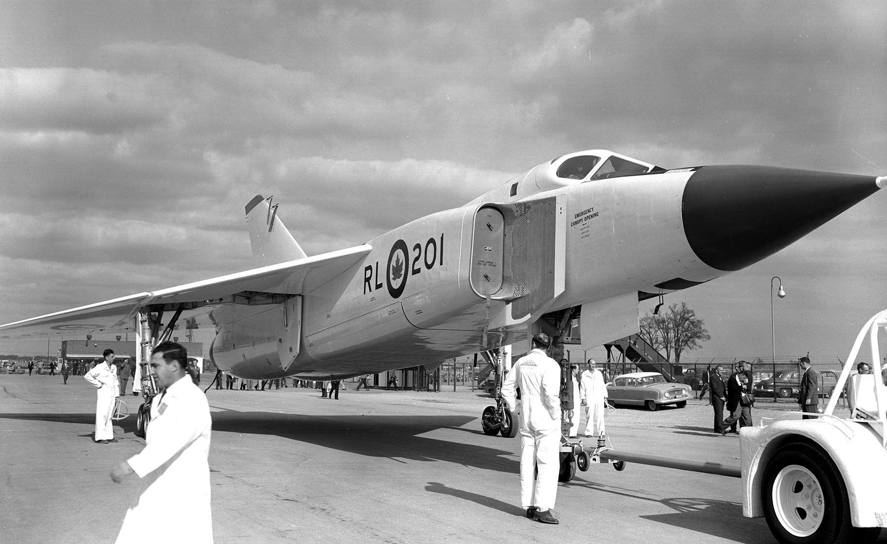 On October 4, 1957, an Avro CF-105 Arrow rests on the tarmac in front of de Havilland's hangar in Downsview, Ontario. PHOTO: DND Archives, PL107100