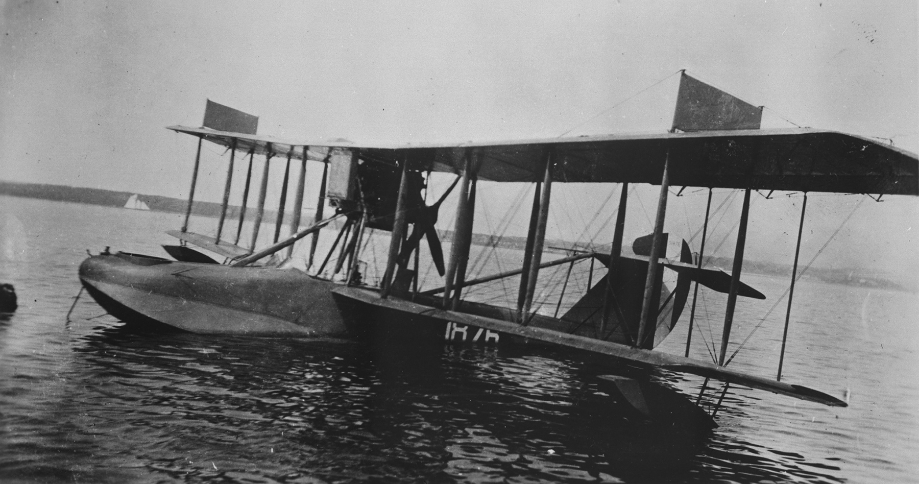HS-2L flying noat No. 1876 moored off the Naval Air Station, Eastern Passage, Dartmouth, Nova Scotia, in spring 1919. This is one of 12 HS-2L flying noats operated by the United States Navy from bases at Halifax and Sydney, Nova Scotia, during 1918. PHOTO: DND Archives, CN-6507