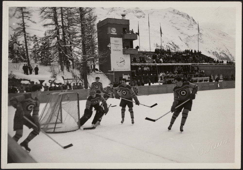 The RCAF Flyers hockey team in action against Sweden's national men's hockey team at the 1948 Winter Olympic Games in St. Moritz, Switzerland. PHOTO: LAC MIKAN no. 4842046