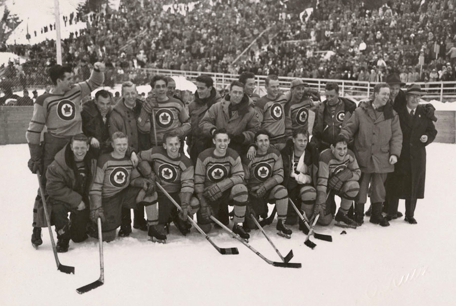 The team photo of RCAF Flyers on the ice after winning the hockey gold medal at the 1948 Winter Olympics in St. Moritz, Switzerland, on February 8, 1948.  PHOTO: LAC MIKAN no. 4842055
