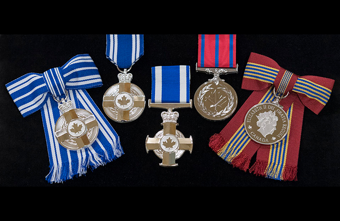 slide - Five medals on ribbons on a black background
