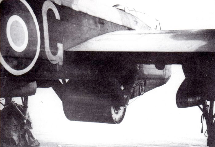 "A photo of the cylindrical ""bouncing bomb"", code-named ""Upkeep"", and its attachment system. Also visible is the chain drive that spun up the bomb to 400 RPM to ensure the bomb ""skipped"" across the water and did not break up. PHOTO: RAF"