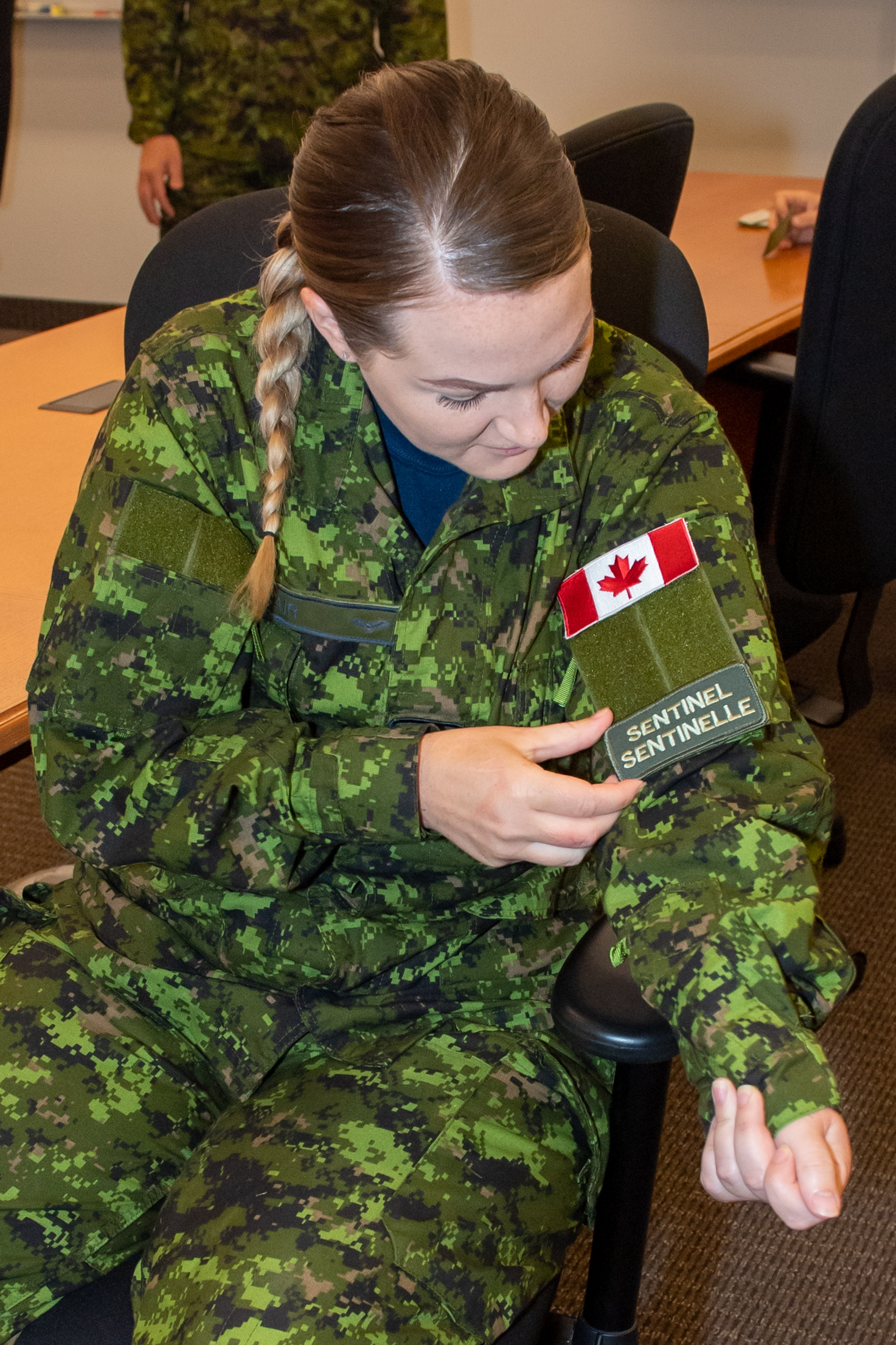 Sergeant Leslie Blair affixes her new patch to her uniform during a ceremony to recognize her participation in the Wing's Lead Squadron Sentinel program on July 13, 2020, at the Admirals Falls Centre, 12 Wing Shearwater. PHOTO: Leading Seaman Laurance Clarke